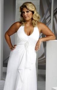 Sexy plus size woman posing in wedding dress